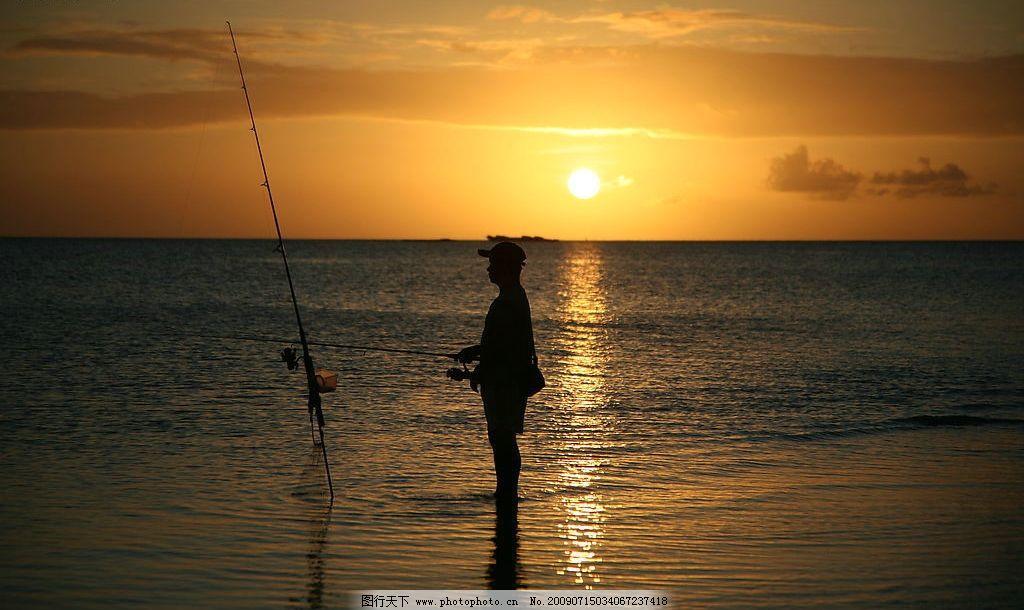 海边落日垂钓图片